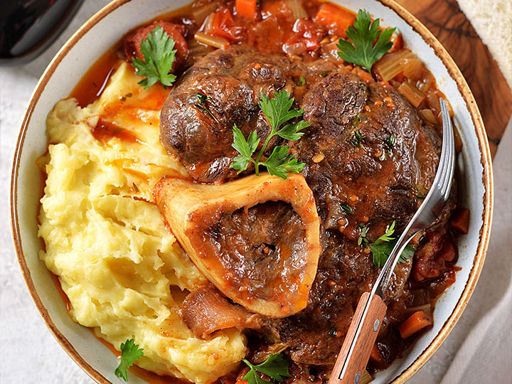 Beef osso bucco with tomatoes and white wine