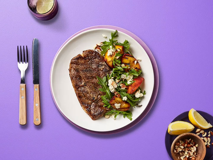 Lamb BBQ chops with grilled peach & rocket