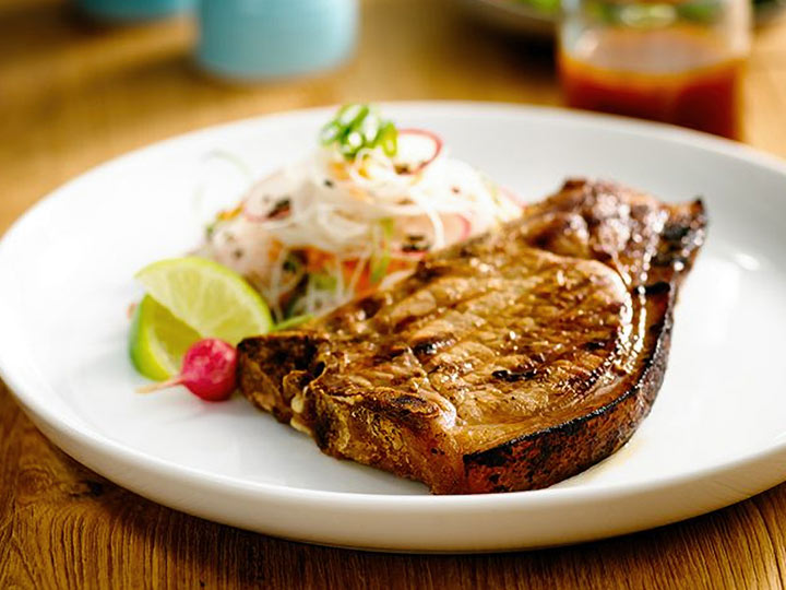 Marinated BBQ pork loin chops with asian noodle salad