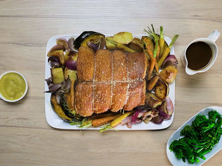 Crackling roast pork with vegetables and gravy