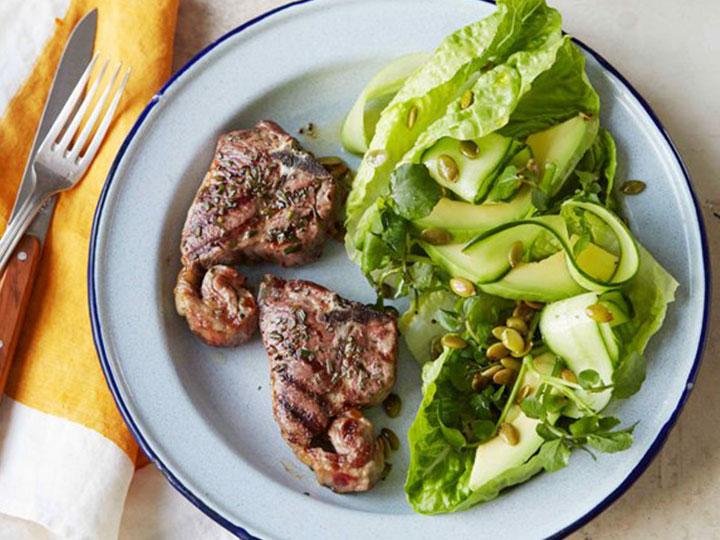 Lamb loin chops with green avocado salad