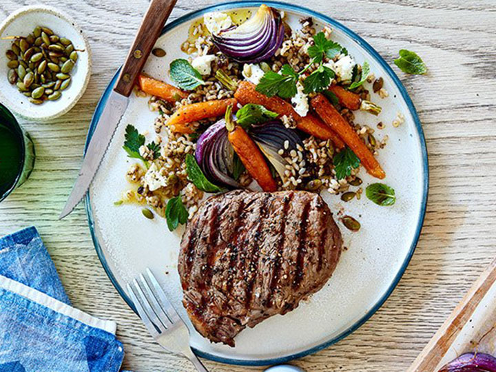 Peppered scotch fillet with carrot & herb salad