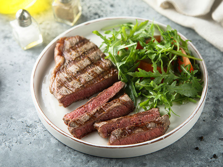 Grilled porterhouse steak with wedges and pepper gravy