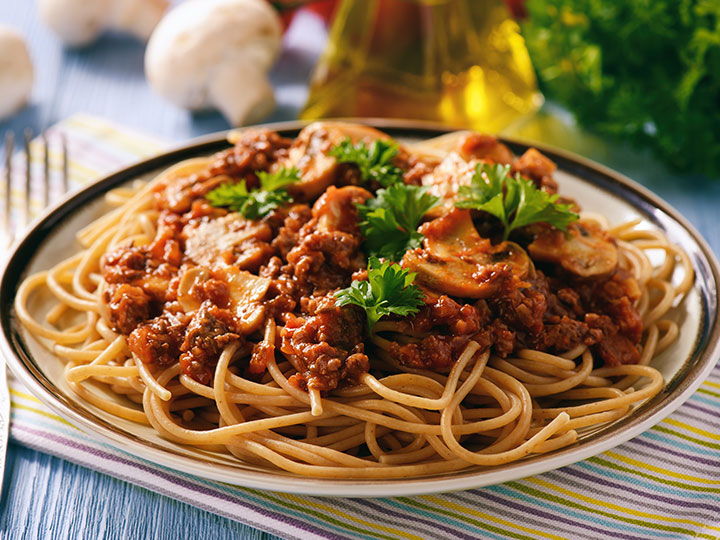 Traditional spaghetti bolognese with mushrooms
