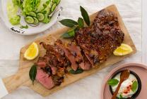 Butterflied lamb leg with roasted vegetables