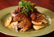 Whole roast duck with apples and cider