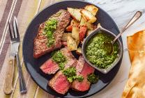 Chimichurri rump steak with potato wedges