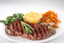 porterhouse steak with sauteed garlic vegetables