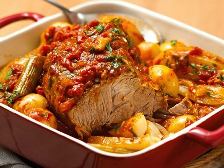 Italian pot roasted pork scotch with potato fennel and tomato