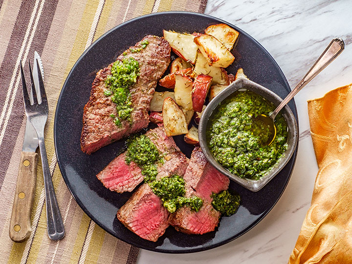 Chimichurri rump steak with potato wedges